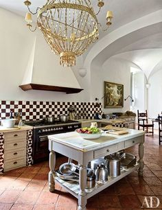 At musician Ned Lambton's Tuscan villa, the kitchen is illuminated by an antique tin chandelier and includes a backsplash of reclaimed Sicilian tiles. The checkerboard pattern fits with the traditional space, but also adds an element of whimsy. Architectural Digest, Home Design, Interior Design, Stylish Interior, Home Luxury, Cocinas Kitchen, Tuscan Design, Rustic Design, Tuscan House