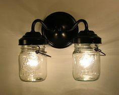 Mason Jars used for something much cooler than storing vegetables or jam, they were turned into a pair of light sconces.