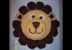 Lion cake with cupcake mane!  Jenna made this for the baby shower!! Thank you so much it was so cute!
