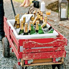 Get creative with how you serve your drinks. This couple served local wines, champagne, and sparkling water in an old wagon.