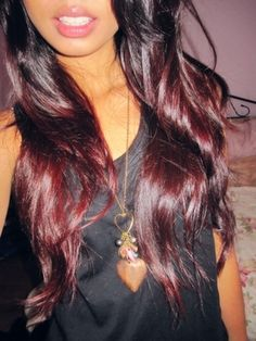 I'm considering doing my blonde ends red for the fall/winter- it would look like this cuz my top is black. Hmmmmm.
