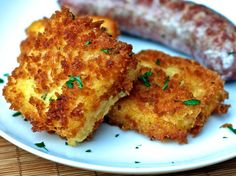 Cheddar Scallion Polenta Croquettes Recipe Appetizers, Side Dishes with water, cornmeal, salt, shredded cheddar cheese, scallions, chopped parsley, eggs, milk, bread crumb fresh, olive oil
