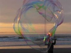 Super giant bubbles at the beach - YouTube