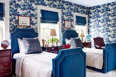 Two of the family's children share a room lined with a Sandberg wallpaper from Stark; the Fine Arts Furniture trundle beds are dressed with RH bedding.