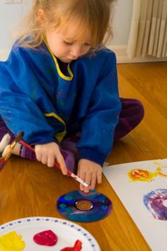 spin painting; children put paint on CDs paper plates etc, then move them like a steering wheel on the paper