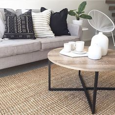 Black patterned cushion and rug