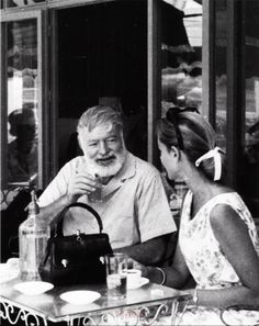 Ernest Hemingway having a drink with Lauren Bacall in Spain, 1959