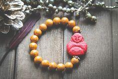 Cinnebar Orange and Red Meditating Buddha by MusingTreeStudios