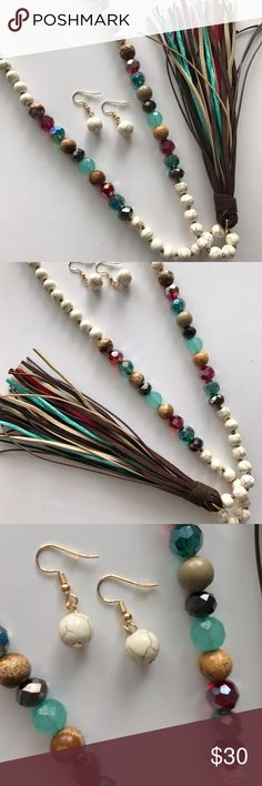 Natural & Darker Multi Tone Set Gorgeous!! This set of natural tones, wood & shimmer beads add a gorgeous pop of color to an outfit. Great quality & beautiful deeper rich tones. Features necklace & earrings. Thick suede tassel with shimmering jade green fabric tassel. Jewelry Necklaces