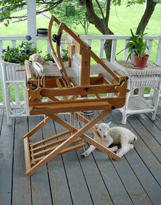 loom (and a friendly fibre friend) looks so peaceful to sit and weave on the porch. take your spinning wheel out and spin. Weaving Loom Diy, Weaving Tools, Weaving Projects, Weaving Art, Hand Weaving, Arts And Crafts, Diy Crafts, Yarn Tail, Weaving Textiles
