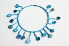 Crocheted blue circle necklace by Shepit on Etsy