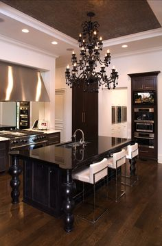 John Kraemer and Sons - black kitchen island, coffee stained kitchen cabinets, black glass chandelier