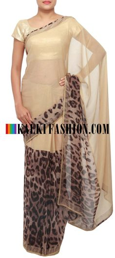 Get this beautiful golden saree here: http://www.kalkifashion.com/gold-foil-saree-embellished-in-animal-print-only-on-kalki.html Free shipping worldwide. #50ShadesOfGold