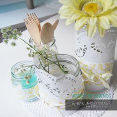 Botes multiusos decorativos hechos con la oblea y las telas de la tarta de pañales de Nueve lunas y un solete.