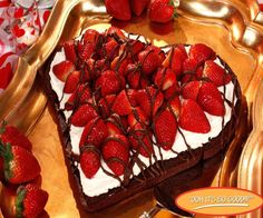 This looks simple to make. Heart shaped chocolate cake or brownie, whipping cream, cool-whip or even buttercream frosting will work, strawberries and melted chocolate or chocolate fudge drizzled on top. Yum!