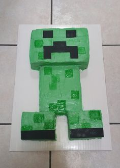 My first attempt at making a creeper minecraft cake for my son.