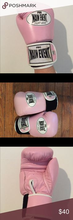 Pro Main Event pink boxing gloves Pro Main Event pink boxing gloves. Gently used. Good condition. Main Event Other