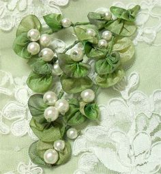 adding pearls to fabric flowers... perfect for all the damn pearls I keep collecting!