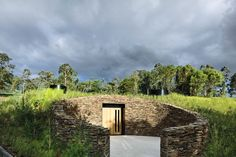 At Tarrawarra Estate, a stone-walled forecourt etched into the side of a hill signals the entry to the cellar door.