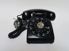 SOLD 1960s black Bell System Western Electric G1 vintage rotary dial desk telephone with metal dial. Original coil cord from phone to handset is very nice as are the graphics on the phone dial pad. This old phone is heavy! 8-27-16