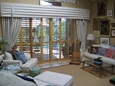 Add some aesthetic appeal to your home with a set of custom wood shutters