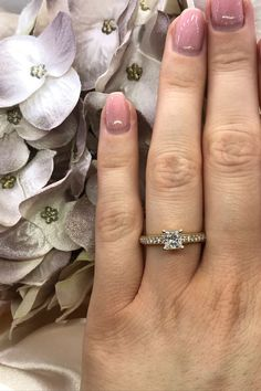 Love vintage style? Then get ready to fall head over heels in love with this diamond vintage engagement ring. This yellow gold engagement ring features a princess cut diamond and a channel of diamonds running down either side of the band.