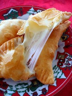 Cheese Empanadas -- Yummy looking! And I bet you could do it semi-homemade using flaky biscuits or phyllo (sp?) dough.