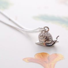 Silver Snail Necklace by Joy Everley, the perfect gift for Explore more unique gifts in our curated marketplace. Unusual Jewelry, Cute Jewelry, Jewelry Accessories, Insect Jewelry, Cute Necklace, Cute Purses, Handcrafted Jewelry, Sterling Silver Jewelry, Jewelery