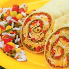 Taco Roll-Ups Recipe:  (not like the photo) 1 pound lean ground beef, 1/2 to 1 (1.25-ounce) package taco seasoning mix,  1/2 cup water, 1 (16-ounce) can refried beans,  6 (10-inch) flour tortillas, 1/2 cup salsa, 3/4 cup shredded cheddar, Monterey Jack, or Mexican cheese blend. Optional: rice, diced tomatoes, corn