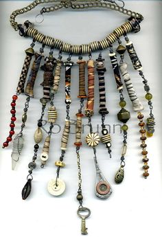 Ro Bruhn - I used lots of my hand made fabric beads in this one    Wow, I love the fabric,the key, the silverware handle...