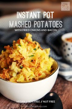 These Instant Pot Mashed Potatoes with fried onions and bacon are going to be your new favorite holiday dish! via @frieddandelions