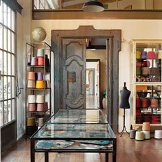 Aged wooden doors, endless spools of yarn, a mannequin...can this be the entrance to my crafting room?