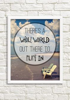 "A digital download of a beach photograph with an inspirational quote that reads, ""There's a whole world out there to play in."" This travel photograph was taken on the beach in St. Augustine, Florida in the summer."