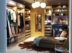 this walk in closet is so great!!! it's amazing how you can fashion a room out of a few ikea pax armoires. Dressing area. Ikea. Chaise lounge.