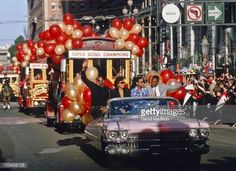 Roger Craig and Jerry Rice of the San Francisco 49ers and their wives Vernessia Craig and Jacqueline Rice ride in a parade down Market Street following the 49ers Superbowl XXIII victory over the...