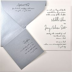 invitation is white cotton laminated to silver-silver envelope  Reception is silver laminated to white cotton  silver & black ink