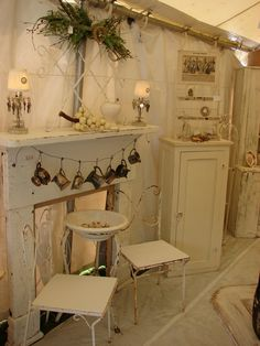 neat garland made of tarnished silver pots. window? The candlestick bobeches are hung with keys!