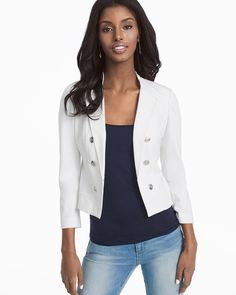 """Bracelet sleeves, easy hook-and-eye closure, comfortable fit...our white ponte jacket is one you can wear anywhere. Consider it your blazer alternative.   White ponte jacket with bracelet sleeves Notched lapels Double-breasted styling with buttons Single hook-and-eye closure Lightly padded shoulders Button-sleeve detail Silvertone hardware Approx. 21"""" from shoulder Rayon/nylon/spandex. Machine wash cold.  Imported Model is 5'10 1/2"""" and wearing XS or size 2"""
