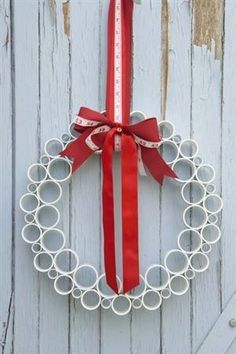 Ashbee Design...PVC Inspiration - wreath from PVC pipe pieces, cut & glued, beribboned.