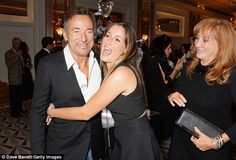 Daddy's girl: Jessica gave her rocker father a big hug as her mother lovingly…