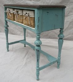Old cabinet painted aqua with baskets added