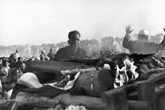 Magnum Photos Photographer Portfolio  Henri Cartier-Bresson INDIA. Delhi. 1948. The cremation of GANDHI on the banks of the Sumna River. Gandhi's secretary watches the first flames of the funeral pyre.