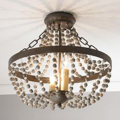 """Rustic French Country Ceiling Light Interchanging glass and stone beads hang delicately from this 3 light rustic bronze convertible semi-flush for a vintage take on a classic design. 3x60 watt candle base bulbs max. (17.5""""Hx18""""W)."""