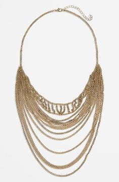 Hot off and on the runway! Love this gold draped chain layering necklace.
