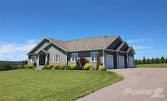 A beautifully maintained and well designed and laid out executive rancher style home with far reaching water views and extending to over 3600 sq ft of finished living space plus a triple attached gar