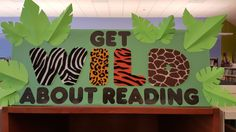 Wild About Reading Library Display It's not anywhere close to unique, but hey, that just makes it classic. This here library display is simple for anyone to do. I'm talking ab… Jungle Bulletin Boards, Jungle Theme Classroom, Reading Bulletin Boards, Preschool Bulletin Boards, Classroom Themes, Holiday Classrooms, School Library Displays, Library Themes, Classroom Displays