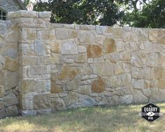 This privacy wall is made with Rustic Bay thin stone veneer from the Quarry Mill. #naturalstone #stoneveneer #thinstone #realstone #quarry #freeshipping #privacywall #masonry #stonedesign #buildingsupplies #stonesiding #quarrymill #landscape Stone Veneer Exterior, Stone Siding, Wall Exterior, Stone Cladding, Thin Stone Veneer, Natural Stone Veneer, Natural Stones, Stone Retaining Wall, Stone Fence