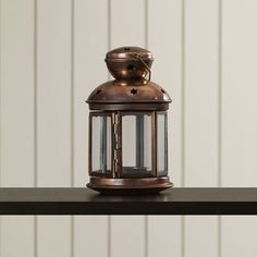 Shop Joss & Main for your Courtney Candle Lantern. Cutouts and glass windows gleam with reflected candlelight in this colonial-style metal candle lamp. Bright burnished finish and a wire hanging loop.