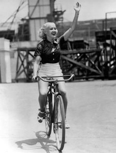 Actress Betty Grable (1916-1973) rockin' out on her bicycle! date unknown.