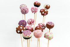 Try these fun and creative 'Chocolate Cake Pops'! They are super easy to make and can be decorated however you like, with interesting colours and shapes. #cakepops #chocolate #yum #partyideas
